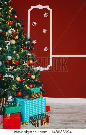 Defocused background Living room with christmas tree and gift