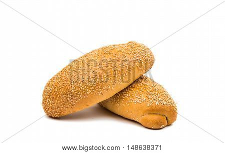 buns sprinkled with sesame seeds on a white background
