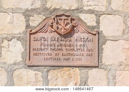 SANTA BARBARA, CALIFORNIA - SEPTEMBER 21, 2016: Plaque Santa Barbara Mission. Sign detailing the history of the Missions construction and restoration after damage from earthquakes.