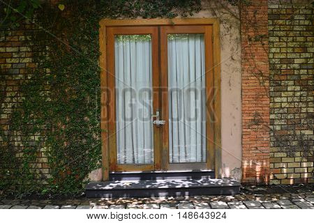 Brick Window With Green Vines In Countryside