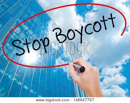 Man Hand Writing  Stop Boycott With Black Marker On Visual Screen