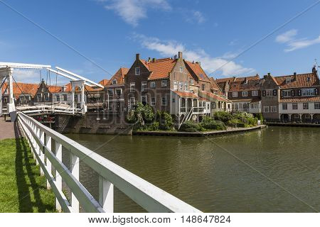 Old houses and draw bridge in the center of Enkhuizen The Netherlands.