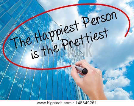 Man Hand Writing The Happiest Person Is The Prettiest With Black Marker On Visual Screen.