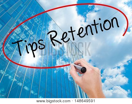 Man Hand Writing Tips Retention With Black Marker On Visual Screen.