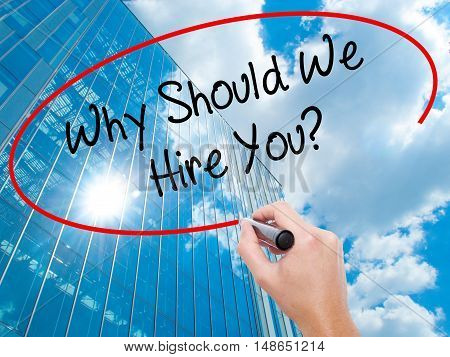 Man Hand Writing Why Should We Hire You? With Black Marker On Visual Screen