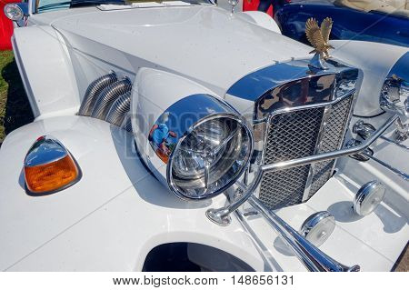 Kharkiv Ukraine - May 22 2016: Close up of neo-classic motor car white Zimmer Golden Spirit manufactured in 1982 is presented at the festival of vintage cars Kharkiv Retro Rally - 2016 in Kharkiv Ukraine on May 22 2016