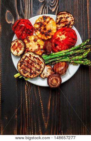 studio shot of grilled vegetables on wooden background or table