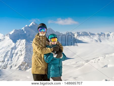 Happy Couple Snowboarders In Mountains