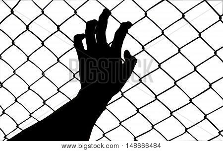 silhouette hand holding on chain link fence
