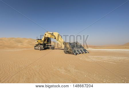 Abandoned Excavator in Liwa desert near Abu Dhabi