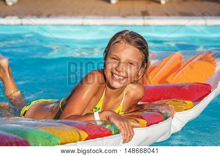 Happy Girl Playing In Blue Water Of Swimming Pool.
