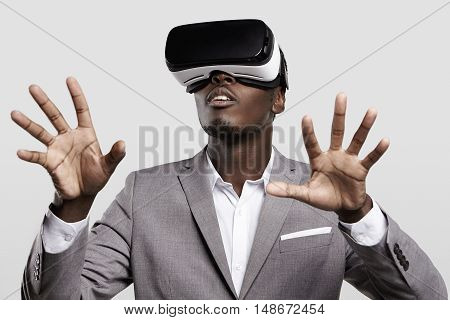 Technology, Gaming, Entertainment And People Concept. African Man Wearing Formal Suit And Virtual Re