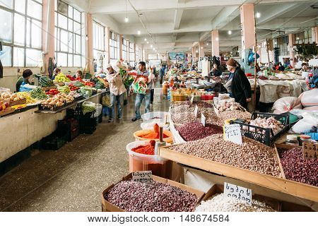 Batumi, Georgia - May 28, 2016: The Scene Of Working Day In Covered Market Bazar. The Sellers Dealers And Buyers Among Abundant Counters With Agricultural Output.