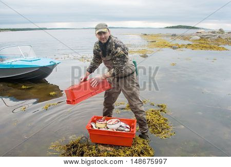 fisherman on the shore of the Barents Sea fish