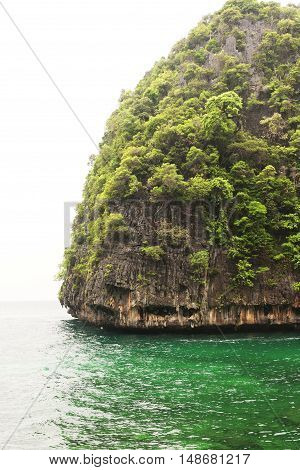 The rocky cliffs of Phi Phi Islands in Andaman Sea Thailand on a rainy day.