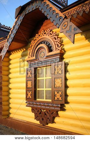 PERESLAVL-ZALESSKIY, RUSSIA - JUL 18, 2015: The wooden building with carved decorations in the historical and cultural center of the Russian park