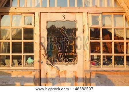PERESLAVL-ZALESSKIY, RUSSIA - JUL 19, 2015: Glass facade with door and window in a wooden guest house
