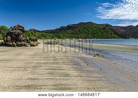 A rock formation on a beach in tropical Queensland Australia.