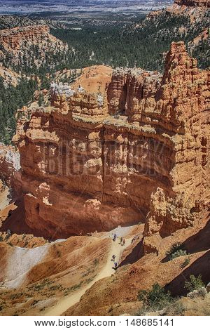 View looking down at Bryce Canyon hoodoos with people on trail