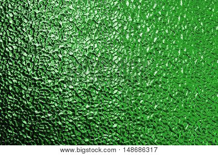 Green glass background. Glass texture, Cracked glass