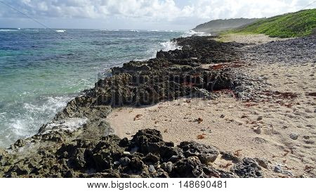 Beach Pebbles, also known Taliseronde beach is located on the island of Marie Galante in the archipelago of Guadeloupe, the French Antilles. Deserted and quiet, this beach is the nesting ground for marine green turtles.