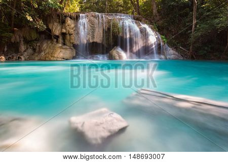 Natural blue stream waterfall, in natural deep forest background