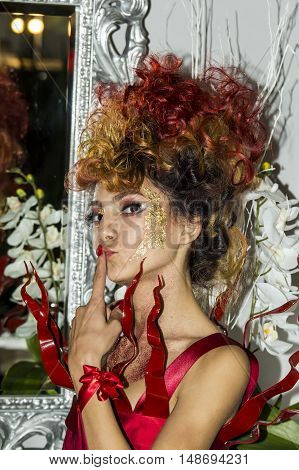 CAGLIARI, ITALY - November 22, 2015: Discovery Extro (fashion makeup and wigs) at the Fiera di Cagliari - portrait of a beautiful girl participant in the demonstration