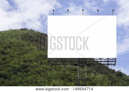 Blank big billboard against green mountain and blue sky background,for your advertising,put your own text here,isolate white on board