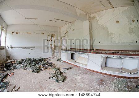 abondoned research chemicals laboratories earthquake army uniform on ground
