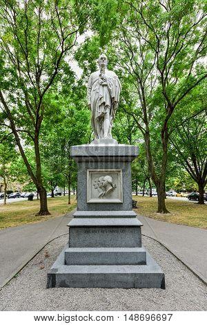 Boston, Massachusetts - September 5, 2016: Alexander Hamilton Monument along the Commonwealth Avenue Mall in Boston Massachusetts.