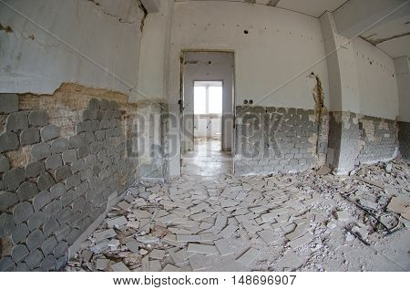 Abondoned building after earthquake heavy damage wall