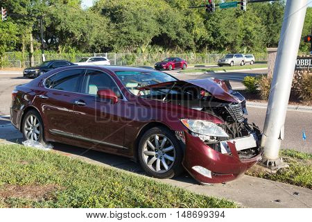 JACKSONVILLE, FLORIDA, USA - SEPTEMBER 23, 2016: A car crashes into a light pole during the morning commute. In 2015, there were 374,445 reported car crashes in Florida.