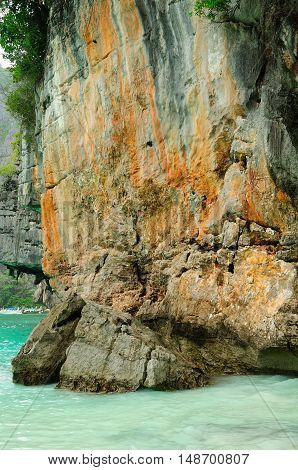 A weathered rock formation on the waters of Maya Bay located on Phi Phi Ley Island in the Andaman Sea Thailand.