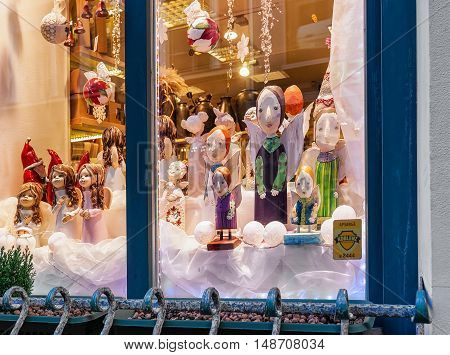 Angel Statues In The Shop Window Of Christmas Riga