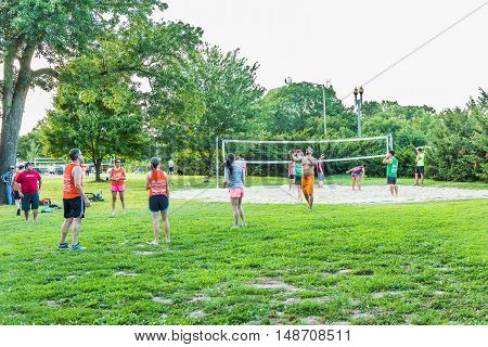 Washington DC, USA - August 4, 2016: People playing volleyball in Lincoln Memorial sand courts by Potomac River