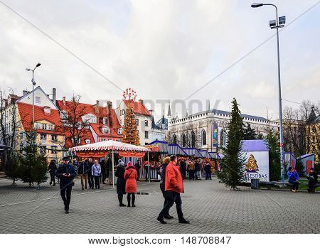 People At Christmas Market At Livu Square Of Riga