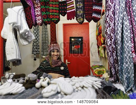Smiling Woman Sells Warm Clothes In The Riga Christmas Market