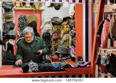 Street Trader Selling Fur Clothes In Riga Christmas Market