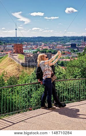 Women Making Selfie With Gediminas Tower And Lower Castle Vilnius