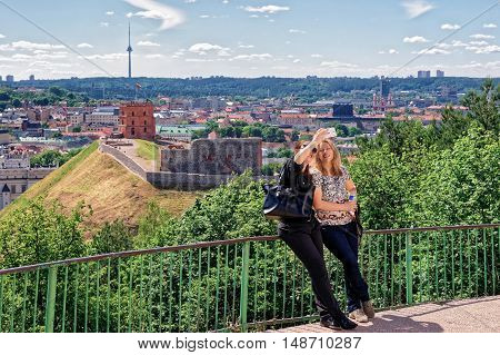 Women Making Selfie With Gediminas Tower And Lower Castle