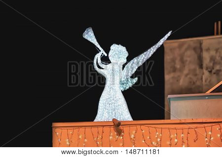 Angel On The Roof Of Building In Riga