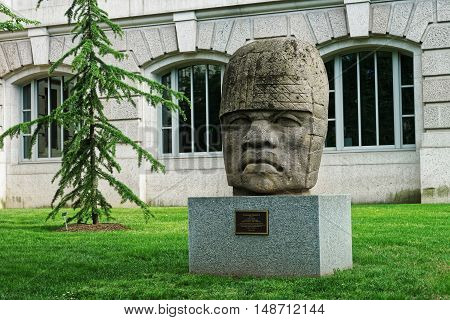 Washington DC USA - May 2 2015: Colossal Olmec Head 4 is located in front of the National Museum of Natural History in Washington D.C. USA. It is one of the 17 colossal heads