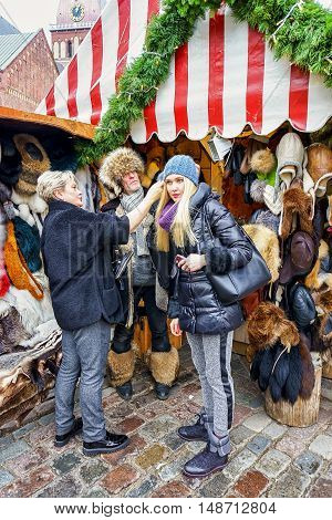 People Buying Fur Clothes At Riga Christmas Market
