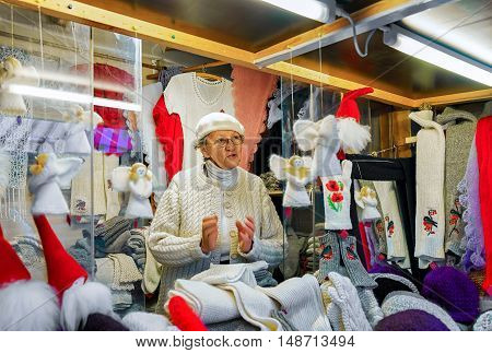 Woman Selling Festive Warm Clothes At Riga Christmas Market