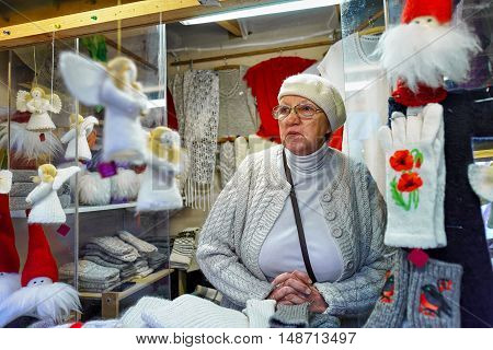 Woman Selling Festive Warm Clothes At The Riga Christmas Market