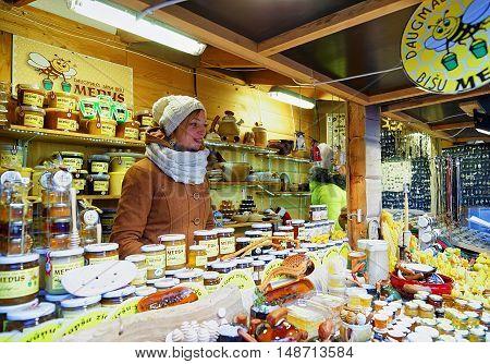 Young Woman Selling Honey At The Riga Christmas Market