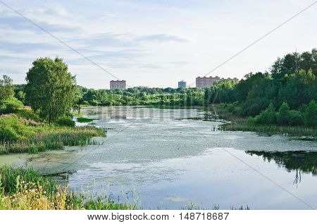 Large Long (Vynohradiv) pond in the North in Moscow. Summer afternoon landscape
