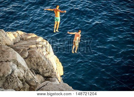 Dubrovnik Croatia  - August 30 2014 Cliff divers jumping into the Adriatic Sea .