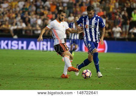 VALENCIA, SPAIN - SEPTEMBER 22nd: (8) Camarasa during Spanish soccer league match between Valencia CF and Deportivo Alaves at Mestalla Stadium on September 22, 2016 in Valencia, Spain