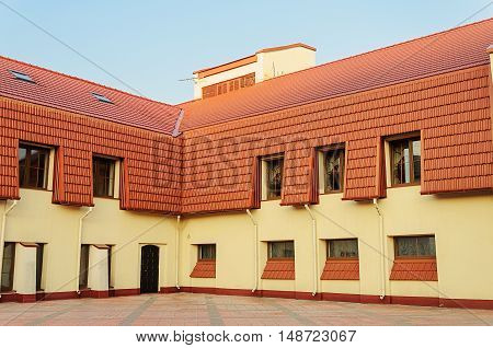 New two-storeyed building with red tiled roof in Trinity Suburb of Minsk Belarus